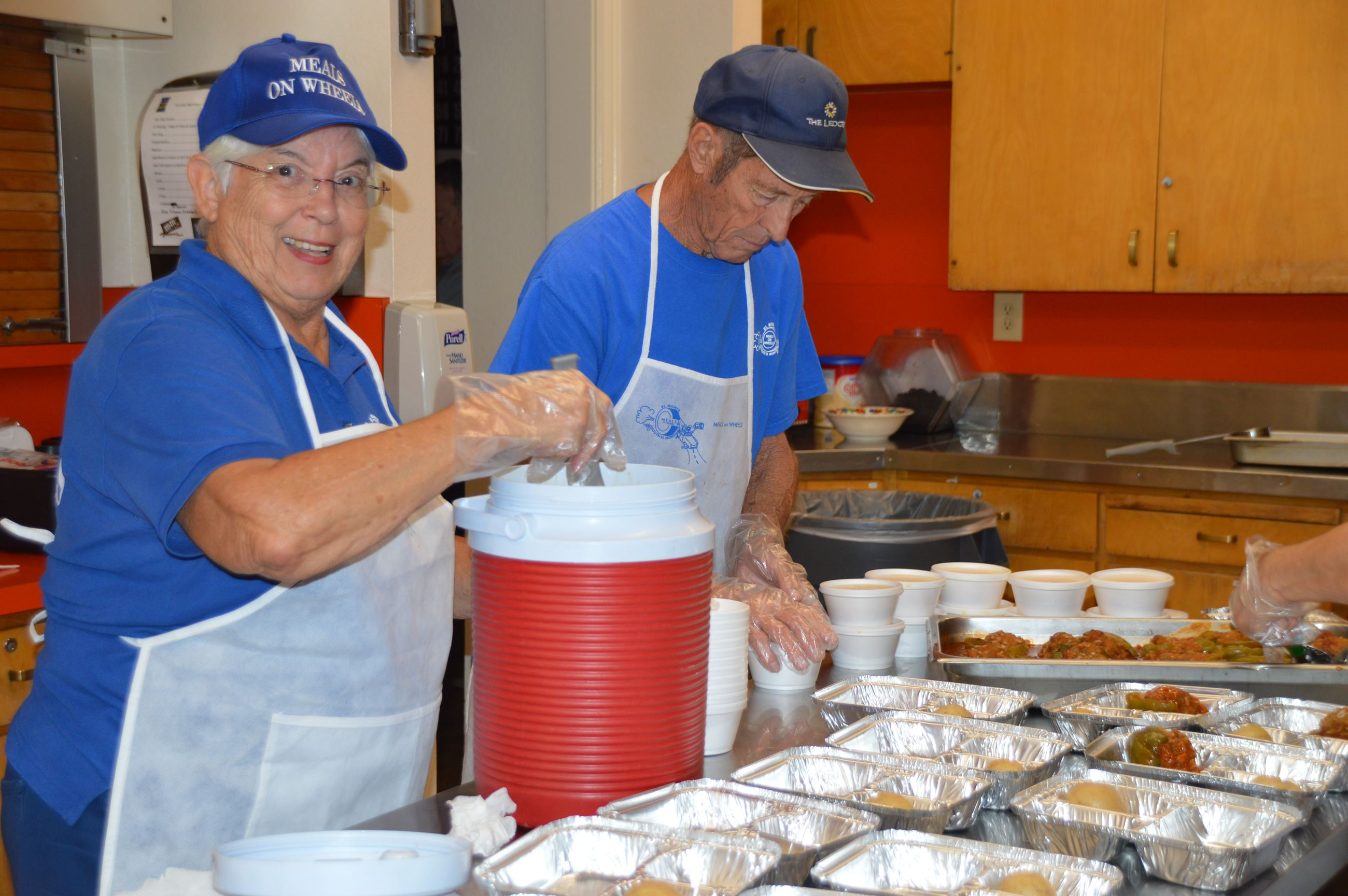 Meals on Wheels volunteers packing meals for the homebound
