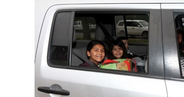 children smiling in car